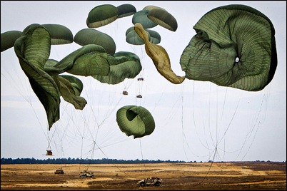 Giant_parachutes_collapse_as_their_load_of_Humvees_hit_the_ground_during_a_joint_operational_access_exercise_on_the_Sicily_drop_zone_at_Fort_Bragg,_N.C.,_on_Feb_130225-A-3108M-015c
